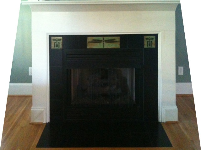 This is the fireplace surround after installation of 3 custom tiles