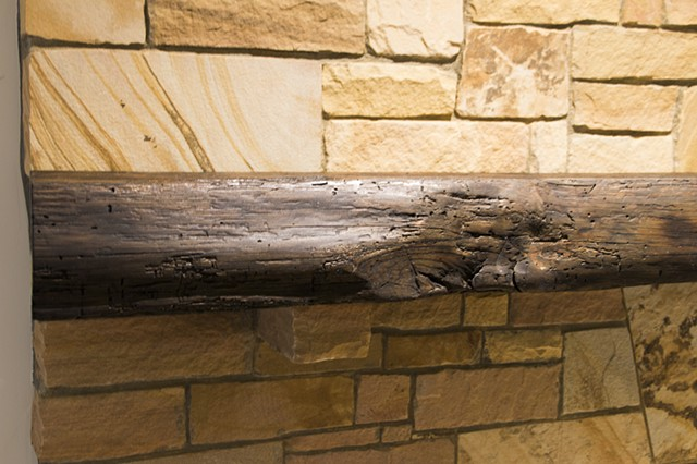 Detail view of front of rustic mantle
