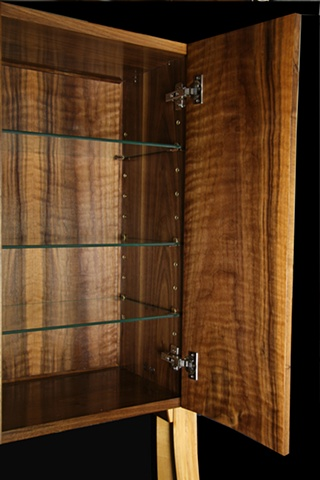 Interior view of walnut cabinet.
