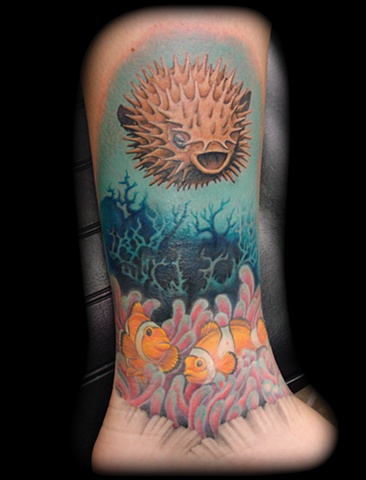 Salisbury Maryland tattoos crucial tattoo studio tattoo water puttef fish reef dolphins fish coral reef tattoos