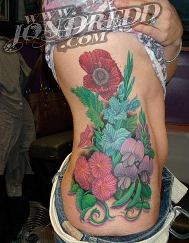 crucial tattoo studio salisbury maryland tattoos jonathan kellogg jon dredd sweet pea flowers bouquet ribs hip tattoo delaware ocean city