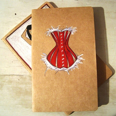 Original art by British Contemporary artist, Linda Boucher. This beautiful Moleskine notebook features Mrs Claus' red silk corset, with white fur trim. A great assest in the run up to the big day.