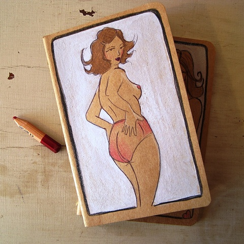 Hand altered Moleskine notebook, by Brighton artist Linda Boucher. The cover of this journal is illustrated with a fierce looking woman, in sheer pink panties. Drawn with ink, aquarelle pencils and gouache- this is a truly unique piece of artwork.