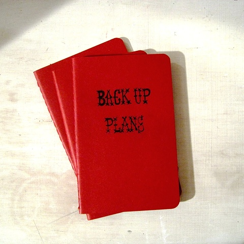Deep red Moleskine Notebook with personalised title hand written by Linda Boucher working from her Brighton studio