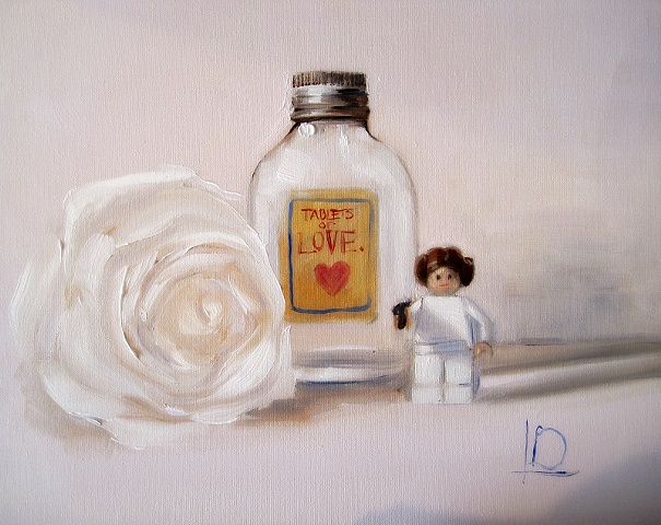 Small original painting in oil on canvas board, of small lego star wars figure Princess Leia, and empty bottle of love pills and a single white rose, by Brighton artist Linda Boucher.
