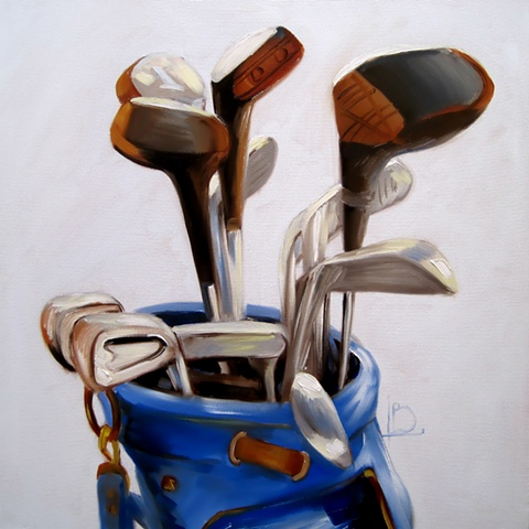 A still life oil painting of a set of golf clubs in a blue golf bag, by Brighton Artist Linda Boucher