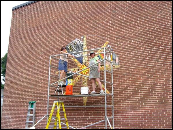 Cheryl Hendershot and I Installing Mural