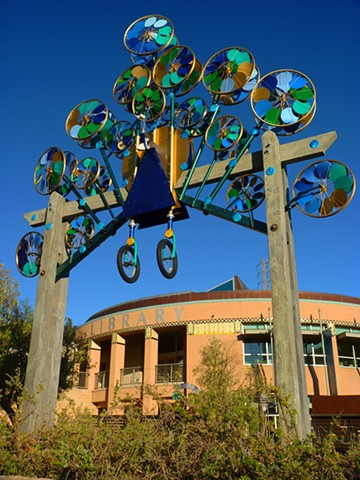 photograph of peacock, kinetic metal sculpture in Orinda California,  by Patricia Vader