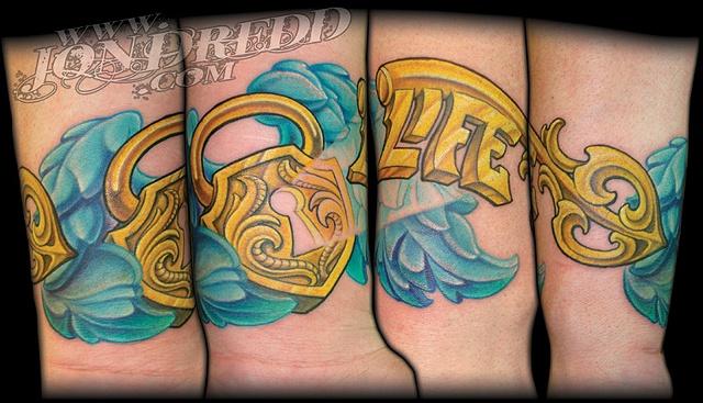 key and lock wings tattoos crucial tattoo studio salisbury maryland ocean city md delaware