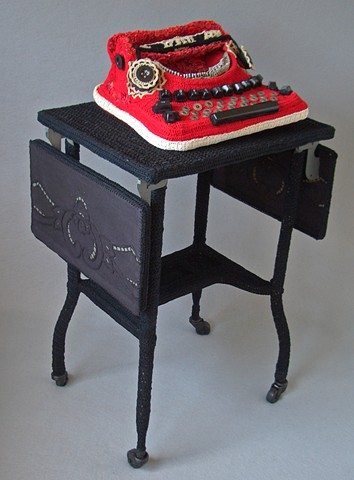 Mixed media sculpture by Marie Bergstedt of typewriter and stand