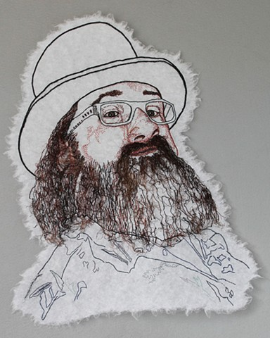 embroidery portrait of bearded menacing man