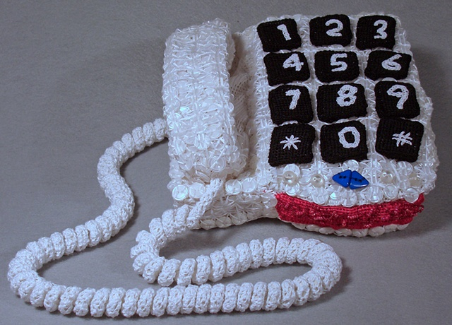 Mixed media sculpture of phone for the disabled