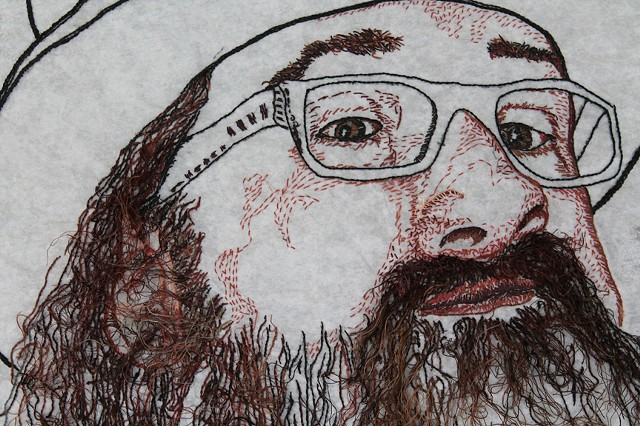 Embroidery portrait of bearded male with hat