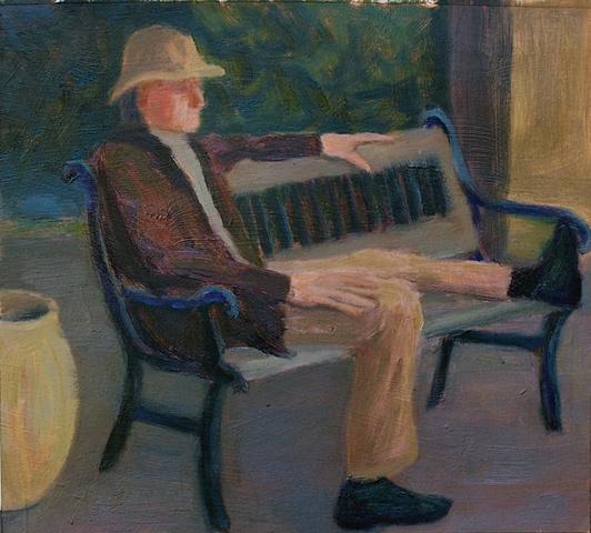 Man Relaxing on Park Bench