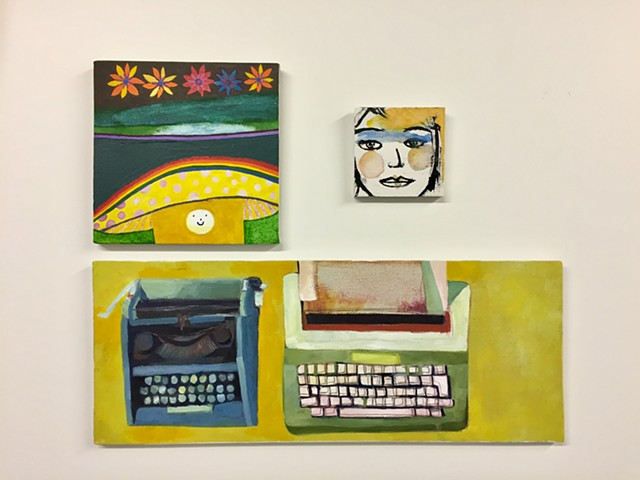 three original paintings by Rochester New York artist Rina Miriam Drescher featuring a happy mushroom, face of a woman, and two typewriters