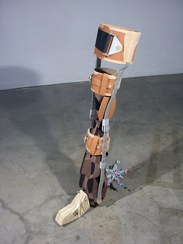 """Poli-Yodel Blues""; club, leg brace, christmas tree star, and two blocks of wood."