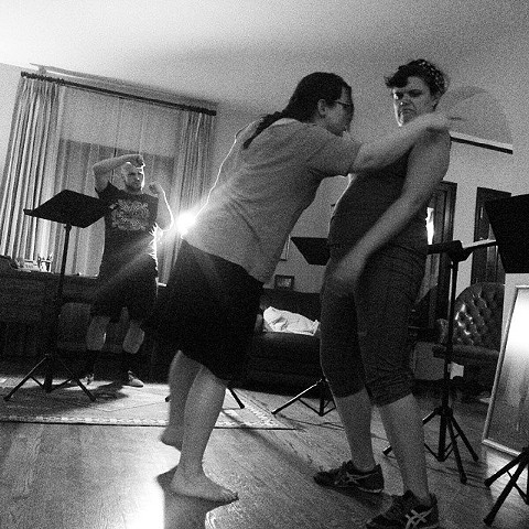 Elizabeth MacDougald, Alison Dornheggan, and Robert Hoffman rehearse for the June 28, 2015 reading