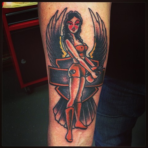 an old school, traditional harley davidson bar and shield pinup tattoo by vincent. vincentiusmaximus