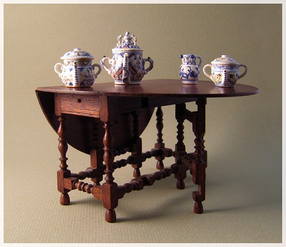 Gateleg table with Posset Pots and Puzzle Jug