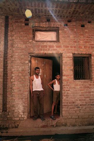 Father and son; Village outside Dhampur, Uttar Pradesh