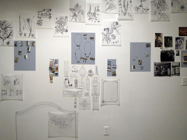 my sketch wall, also where I sell my jewelry and collage my work