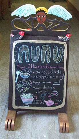 Nunu sandwich board sign - side one