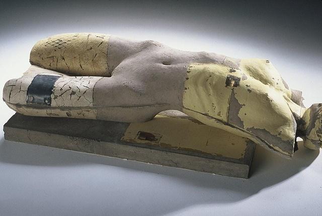 A figure in repose, sculpted by artist Dan Corbin.
