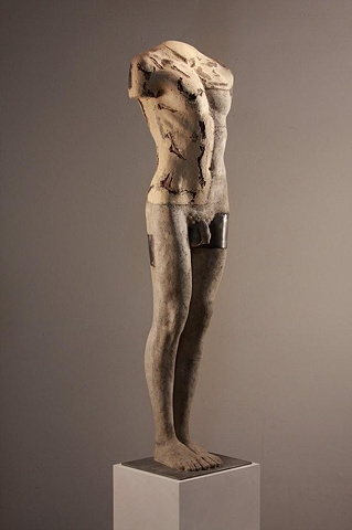 Sculptor Dan Corbin used wood and bauxite to create male form from live model.