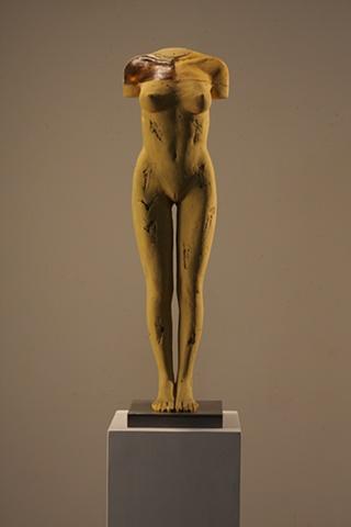 Nude sculpture by Dan Corbin features glass, wood bauxite.