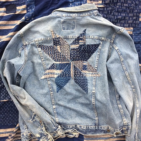 Custom denim repair, sashiko stitched 8 point star