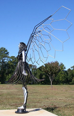 The sculpture represents how guardian angels can exist on this earth.
