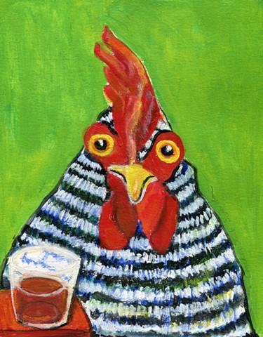 A chicken stands next to a shot glass.