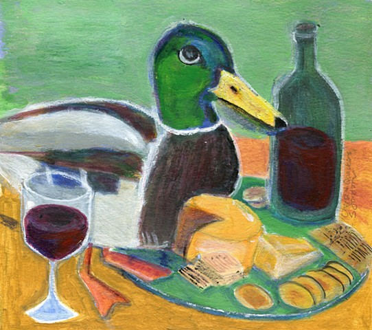 A mallard duck, a bottle of wine, a glass of wine, some cheese, some crackers