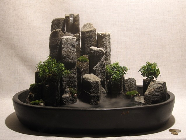 miniature basalt columnnar iceland waterfall with plants and miniature puffins