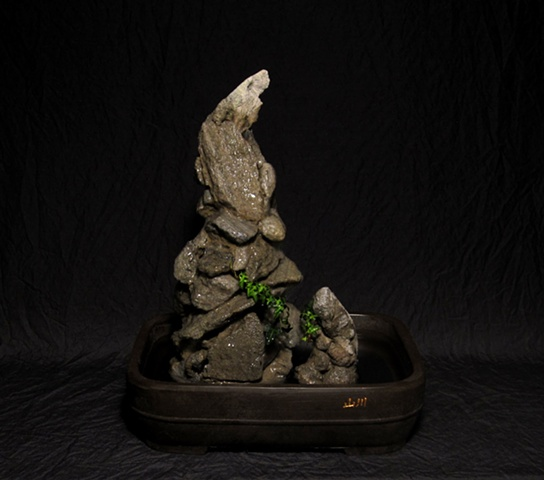 feather rock cairns in animal totem shapes with ivy