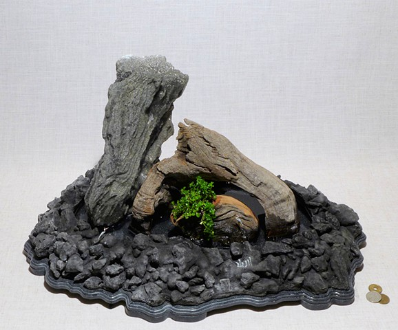 feather rock fountain with driftwood, miniature cranes, and Corian base