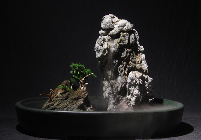 zen indoor fountain rock sculpture with jasmine, fogger, and chinese figurines