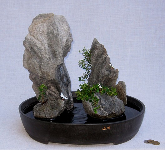 Asian feather rock fountain with miniature cranes
