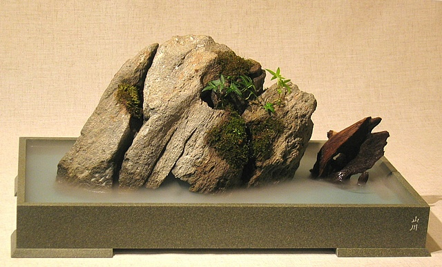 zen indoor fountain rock sculpture with plant and fogger
