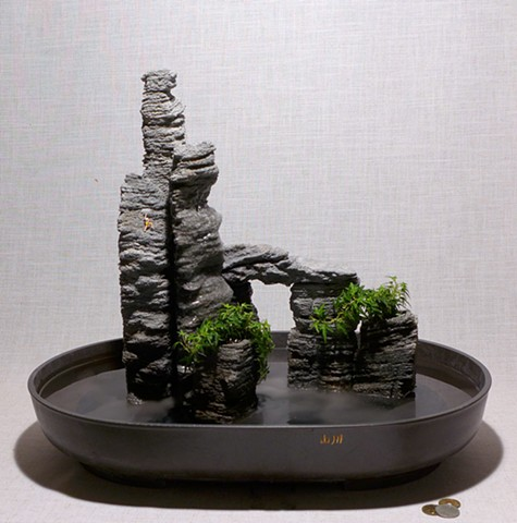 eroded feather rock towers with fogger, waterfall, ivy, miniature climber
