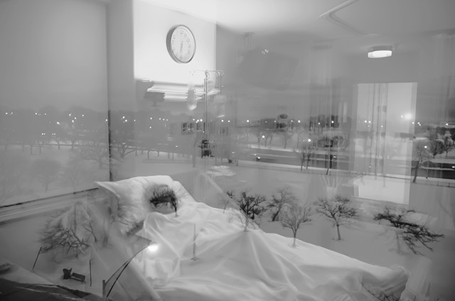 double exposure of a woman in a hospital bed super imposed on the the view from the indown of a park and it looks like sh's making a transition photographed by Lucy Mueller Photogrpahy