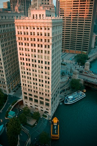 Sun setting on the Chicago River where it meets Lake Michigan taken from the balcony of Trump Tower photographed by Lucy Mueller Photography
