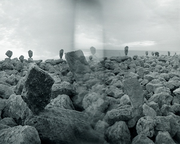 Holga camera image of rock balancing along Lake Michigan by lucy mueller
