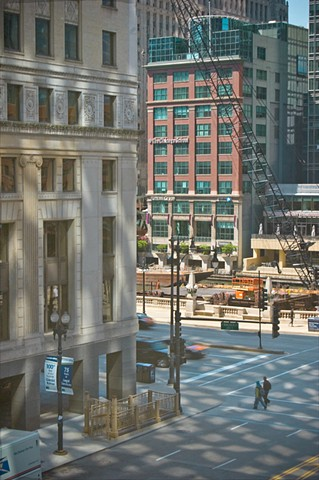Downtown in Chicago's loop with strong shadows creating a checkerboard pattern photographed by lucy Mueller photography