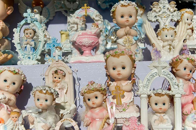 Religious pastel angels and dolls in the window of a store in Milwaukee avenue photographed by lucy mueller
