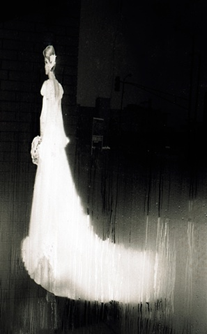 An illustration of a bride behind a window with condensation at a dry cleaner's by Lucy Mueller
