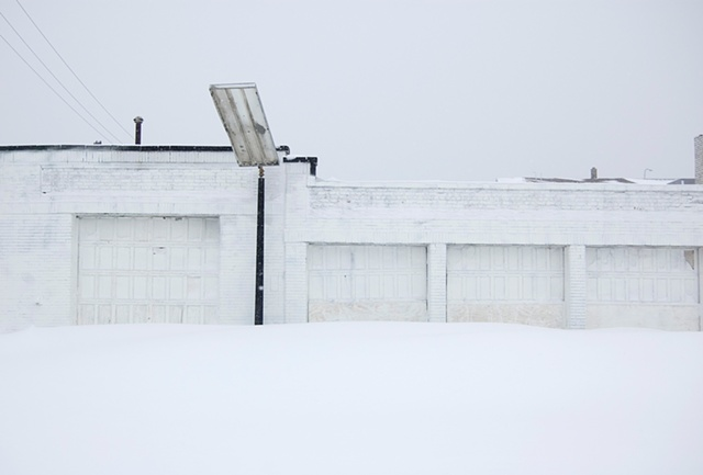 After a big snow storm a white gas station blends in photographed by Lucy Mueller