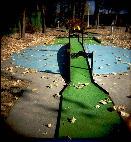 A miniature green bridge on a miniature golf course in Diversey harbor at the Chicago Park District photgraphed by Lucy Mueller