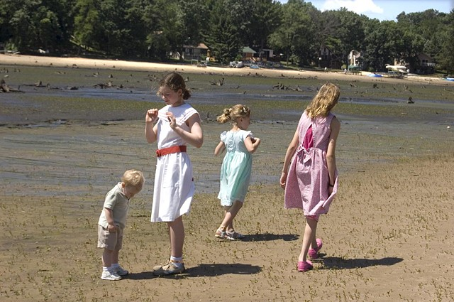 Children in their Sunday best stand in what was once Lake Delton in Wisconsin after the lake drained photographed by lucy mueller