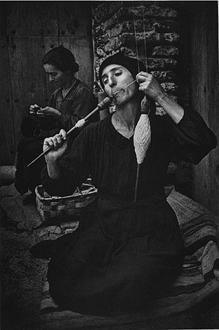 """The Spinner"" photo by Eugene Smith of woman spinning wool from Spanish Village series published by LIFE Magazine"